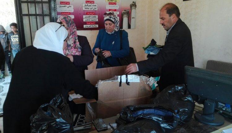 جمعية نور السما الخيريه  توزيع ملابس علي الطلبة في مادبا