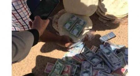 """العراق يضبط أموال مهربة داخل """"أرغفة خبز"""" قادمة من الأردن"""