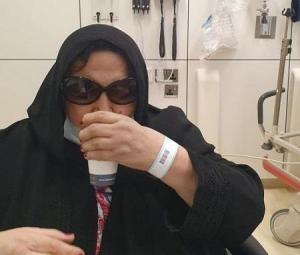 ظهور لسميرة توفيق بالحجاب والكمامة