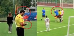 """بالفيديو .. حكم """"يلكم"""" لاعبا ويستخدم هاتفه خلال المباراة .. شاهدوا ماذا وثّقت الكاميرات"""